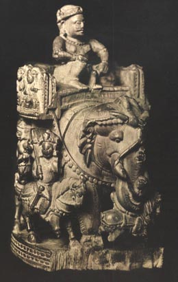A traditional carving of a royal figure on an elephant back (on a howda), probably the original form of the shatranj chess king